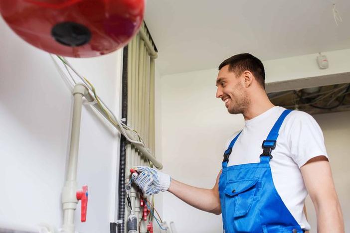 builder or plumber working indoors
