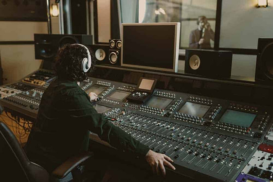 Sound producer working at studio while recording song