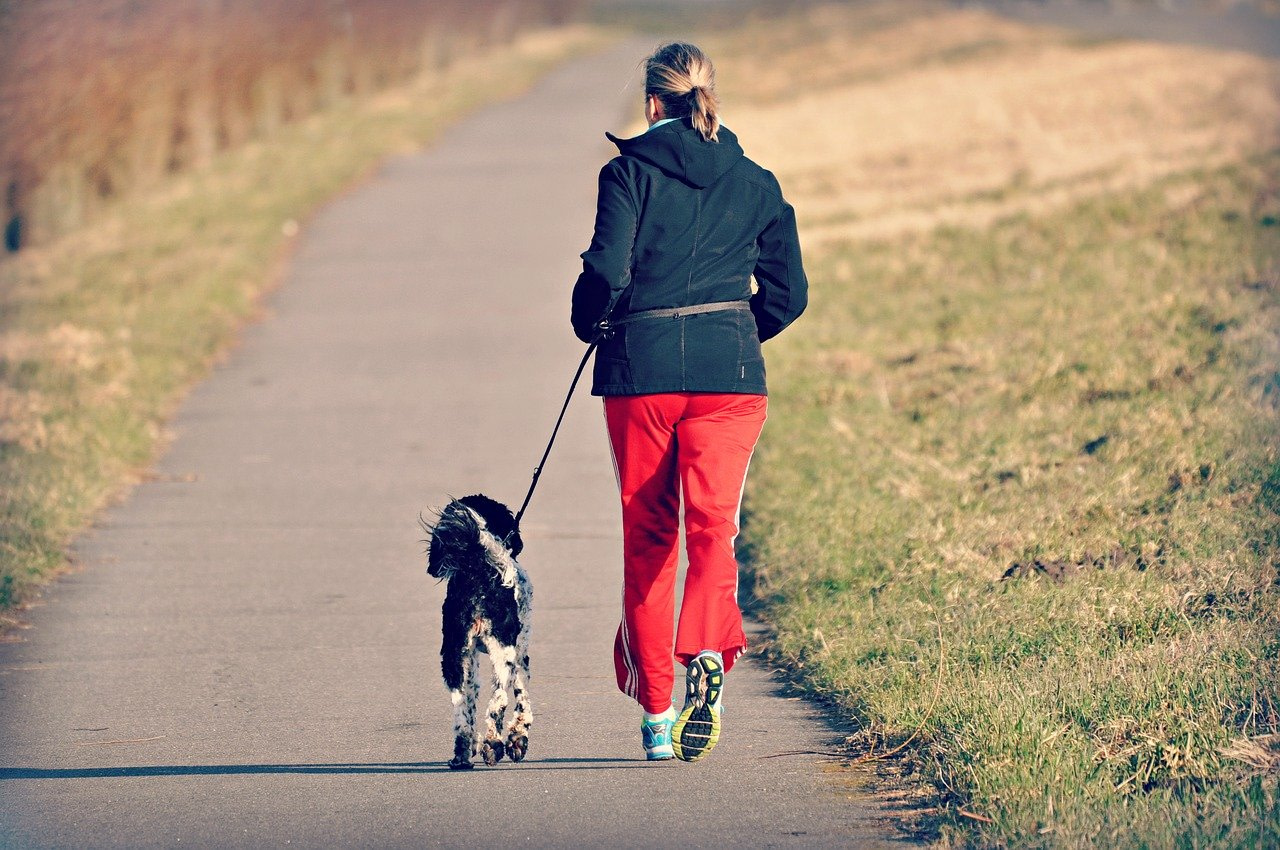 a woman who jogs with her dog