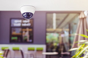 Surveillance camera installed on ceiling to monitor for protection