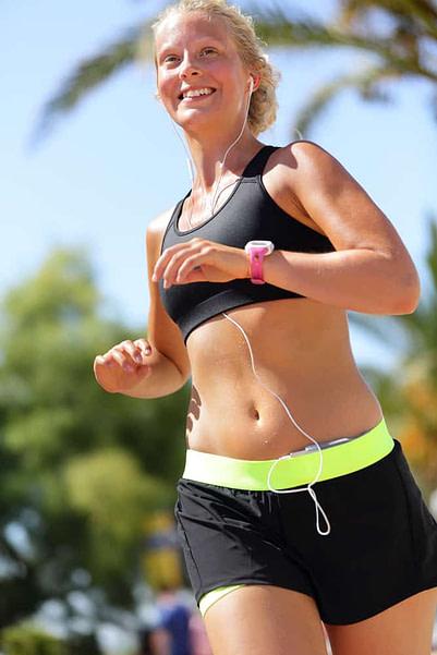 Runner running wearing smartphone and smartwatch