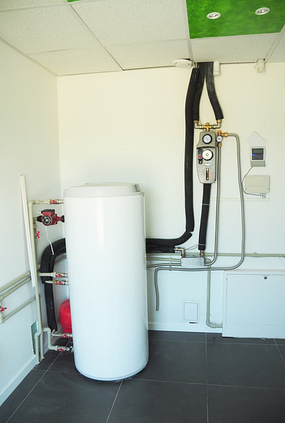 Boiler & Heating System Controls. Household boiler room with a new modern gas boiler, heating electric warm water system and pipes. Boiler Controls and Thermostats