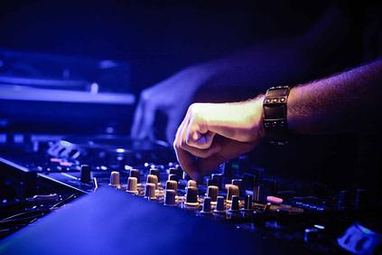 The DJ mixing in studio with great headphones