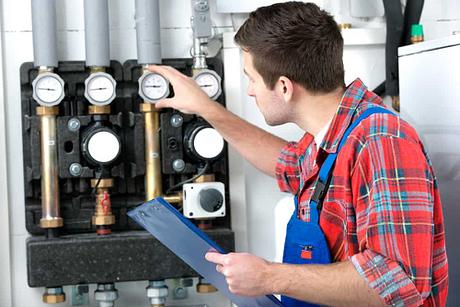 Technician servicing water heater