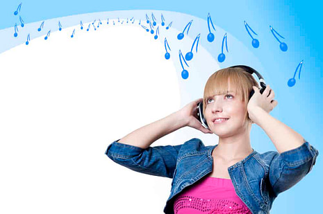 Young attractive woman listing to music