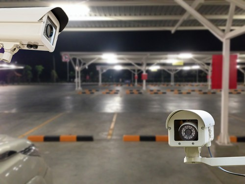 CCTV Security Camera operating in parking lot caพ.