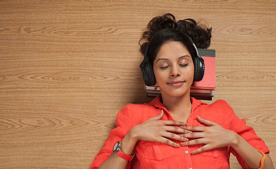 Woman listening to music on closed back headphones under 200