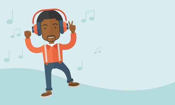 Happy young man dancing while listening to music