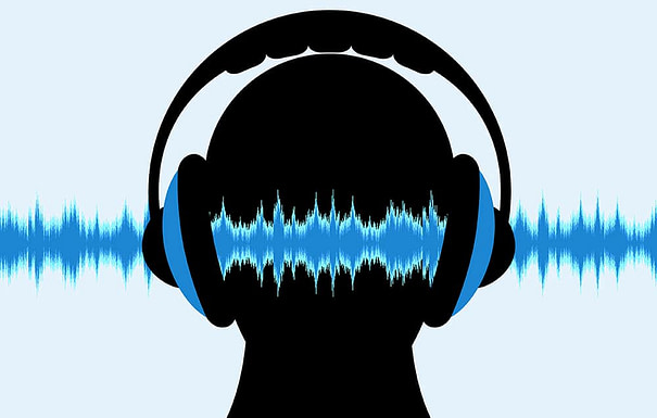 soundwaves passing through head with headphones and binaural beats